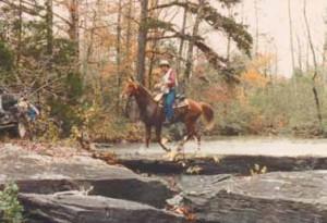 Bill Hinkebein and Country Gold cross a creek at the 1991 Arkansas Traveler NATRC ride near Dover, AR